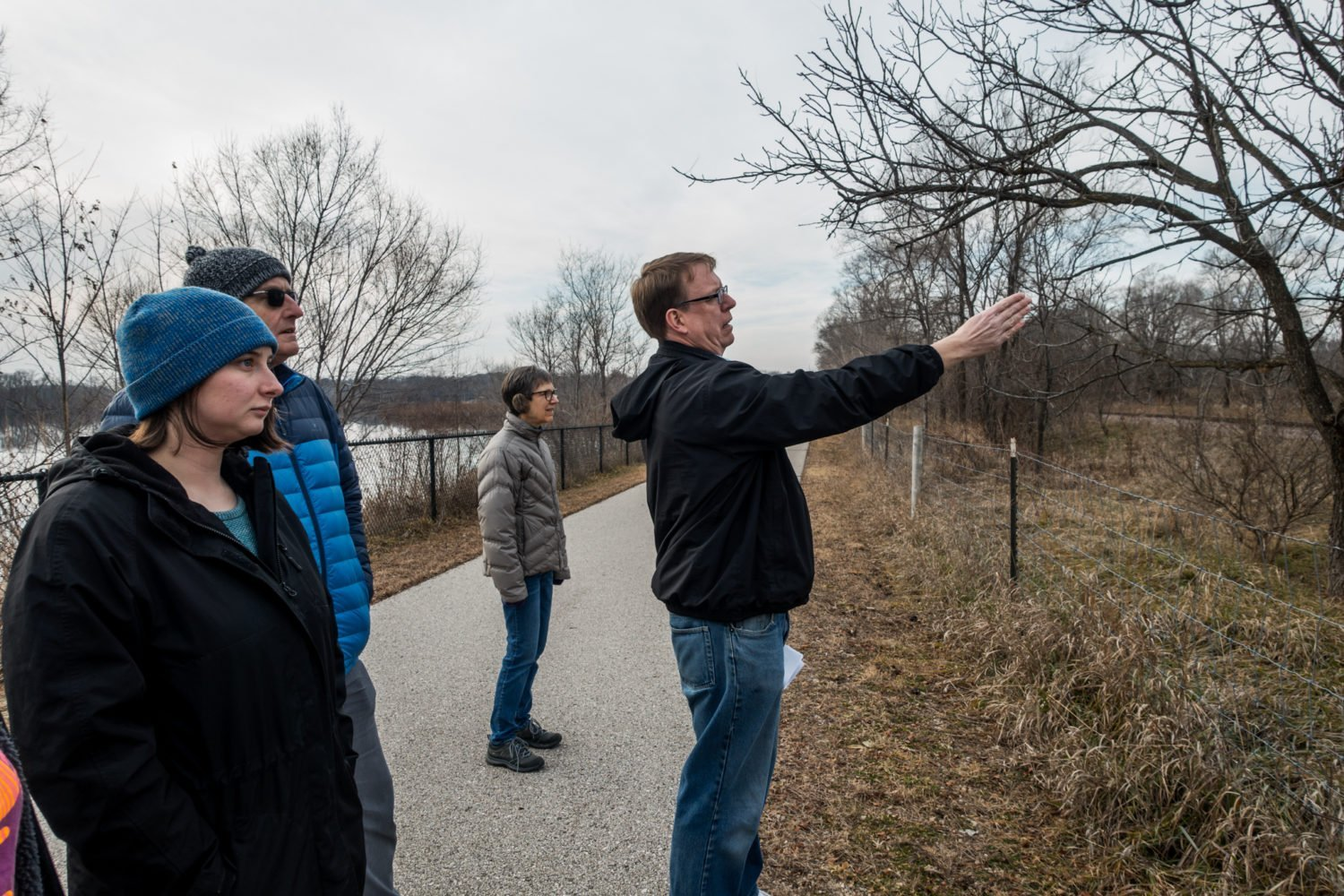 Senator Rob Hogg points out the land proposed for a new Cargill rail yard from Prairie Park Fishery in Cedar Rapids, Iowa