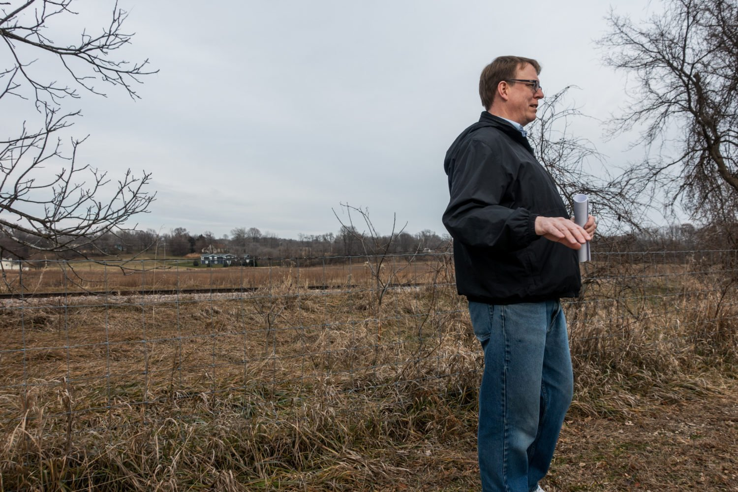 Senator Rob Hogg stands in front of the Prairie Pollinator Zone in Cedar Rapids, Iowa
