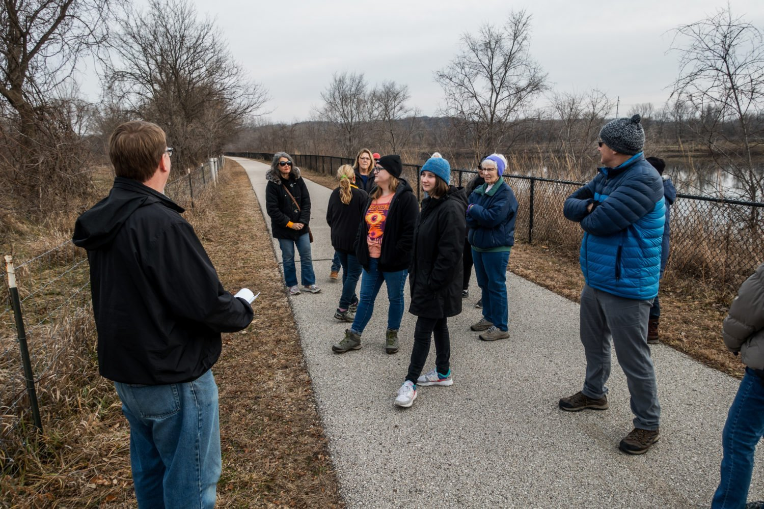 Senator Rob Hogg leads a group through the Prairie Park Fishery in Cedar Rapids, Iowa